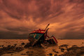 Shipwreck which used to be fishing boat in the sunset Royalty Free Stock Images