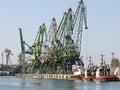 Shipyard cranes and tug boats in Varna , Bulgaria Royalty Free Stock Photo