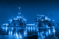 Shipyard oil rig at night in industry concept Stock Photo