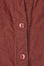 Shirt buttons close up of the of a brown ladies top Stock Photo