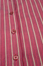 Shirt buttons detail take of on a striped cotton fabric Royalty Free Stock Photo