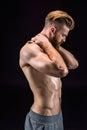 Shirtless bearded bodybuilder posing isolated on black Royalty Free Stock Photo