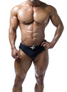 Shirtless male bodybuilder really muscular body in trunks with ripped abs pecs and arms Royalty Free Stock Photo