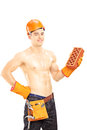 Shirtless male construction worker with helmet holding brick muscular a isolated on white background Stock Photography