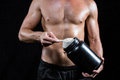 Shirtless man scooping up protein powder Royalty Free Stock Photo