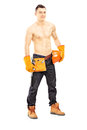 Shirtless muscular male construction worker full length portrait of a isolated on white background Stock Image