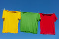 Shirts on clothesline multicolor in sunny day Stock Photo