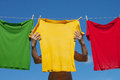 Shirts on clothesline multicolor in sunny day Stock Images