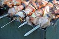 Shish kebab dof on skewers and hot coals Royalty Free Stock Images