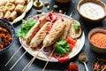 Shish kebab, meat skewers or shashlik served with grilled vegetables
