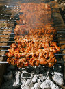 Shish kebab with the mix of spices on bbq cooking and coal Royalty Free Stock Photo