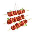 Shish kebab on skewers with onions and tomatoes.