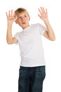 Shock and awe young boy showing an expression of looking at something unpleasant or frightening Stock Image