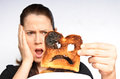 Shock woman holds a burnt slice of toast Royalty Free Stock Photo