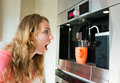 Shock woman making coffee cup machine young kitchen interior Stock Photos