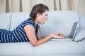 Shocked brunette looking her laptop