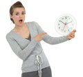 Shocked business woman pointing on clock Stock Image