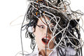 Shocked businesswoman with cables on head Stock Image