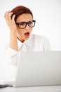 Shocked businesswoman looking at her laptop Royalty Free Stock Images
