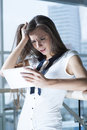 Shocked businesswoman reading tablet device Royalty Free Stock Photography