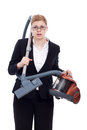 Shocked businesswoman with vacuum cleaner Stock Photo