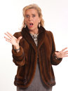 Shocked elegant mature lady portrait of a senior in a mink coat Stock Photos