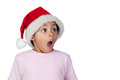 Shocked girl wearing santa hat over white background Royalty Free Stock Photos