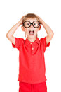 Shocked kid portrait of a schoolkid in spectacles isolated over white background Royalty Free Stock Image