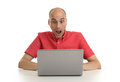 Shocked man with his laptop young computer Stock Image