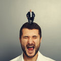 Shocked man with small happy boss portrait of men on the head Stock Image