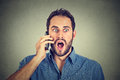 Shocked man talking on mobile phone Royalty Free Stock Photo