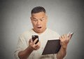 Shocked middle aged man looking at phone Royalty Free Stock Photo