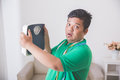 Shocked obese man while looking at a weight scale Royalty Free Stock Photo