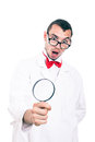 Shocked scientist with magnifying glass in lab coat looking at isolated on white background Stock Photo