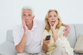 Shocked senior couple watching television Royalty Free Stock Photo