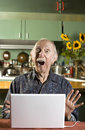 Shocked Senior Man with a Laptop Computer Royalty Free Stock Photo