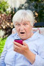 Shocked Senior Woman with Smartphone Royalty Free Stock Photo