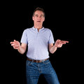 Shocked surprised confused man hands raised middle age black background Royalty Free Stock Image