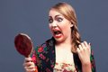 Shocked woman in a with mirror Royalty Free Stock Photo
