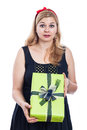 Shocked woman with present holding green gift box isolated on white background Stock Photo