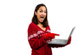 Shocked woman using laptop while wearing warm clothing portrait of against white background Royalty Free Stock Photo