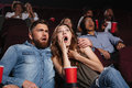 Shocked young couple watching a horror movie Royalty Free Stock Photo