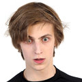 Shocked young man caucasian with amazed scared face expression on white background Stock Photos