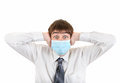 Shocked young man in flu mask covering his ears isolated on the white background Stock Images