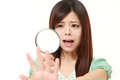 Shocked young woman looking through a magnifying glass her nails Royalty Free Stock Photo