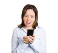 Shocking text message closeup portrait mature shocked business woman corporate employee looking at cell phone seeing a bad or Stock Photo