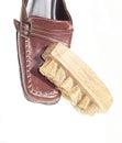 Shoe brush on shoes isolated Royalty Free Stock Photo