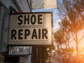 Shoe repair sign service on city street Stock Image