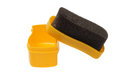 Shoe shine foam brush saturated with neutral polish Royalty Free Stock Photo