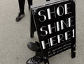 Shoe shine here portmeirion wales september th a a sign for near the dr martins shop during festival no th september in Royalty Free Stock Photos